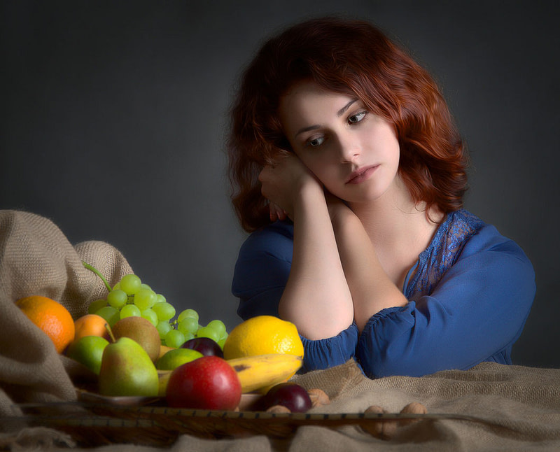 Woman and fruits